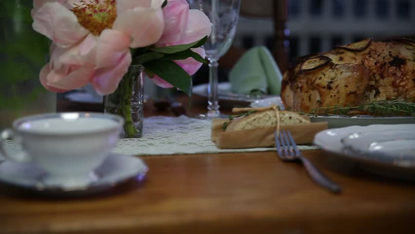 Panning across an outdoor dinner table with food and dishes | Shutterstock HD Video #1026313703
