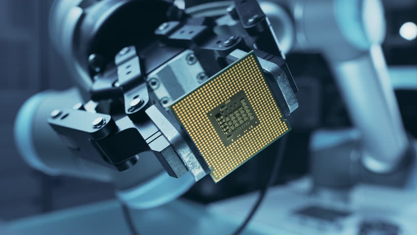 Modern High Tech Authentic Robot Arm Holding Contemporary Super Computer Processor Smoothly Moving into Focus. Industrial Robotic Manipulator End Effector Holding CPU Chip Moves Towards Camera Focus   Shutterstock HD Video #1026344633