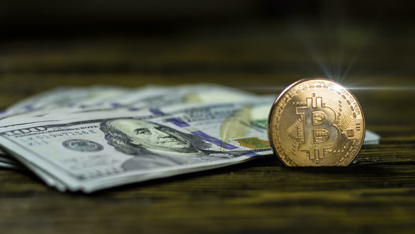 Bitcoin cryptocurrency coin on a wooden surface   Shutterstock HD Video #1026348923