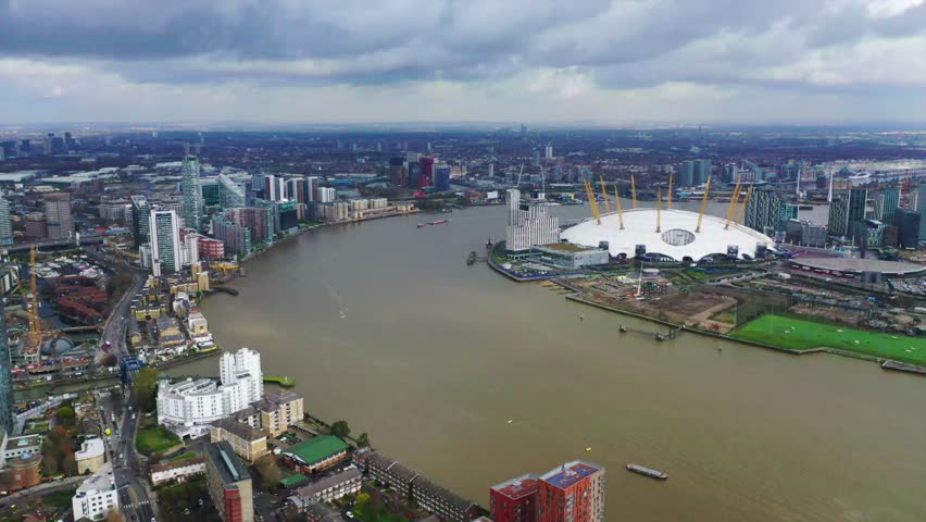 Greenwich Peninsula, London / United Kingdom - March 18 2019: Aerial drone bird's eye view video of iconic concert Hall of O2 Arena in North Greenwich #1026441773