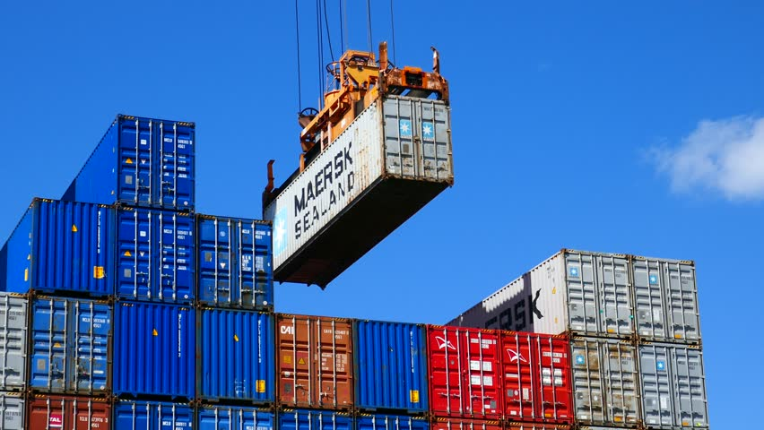 Haifa, Israel - 27.3.2019 : Loading container to ship by industrial line gantry crane 4k  creative business video  4k