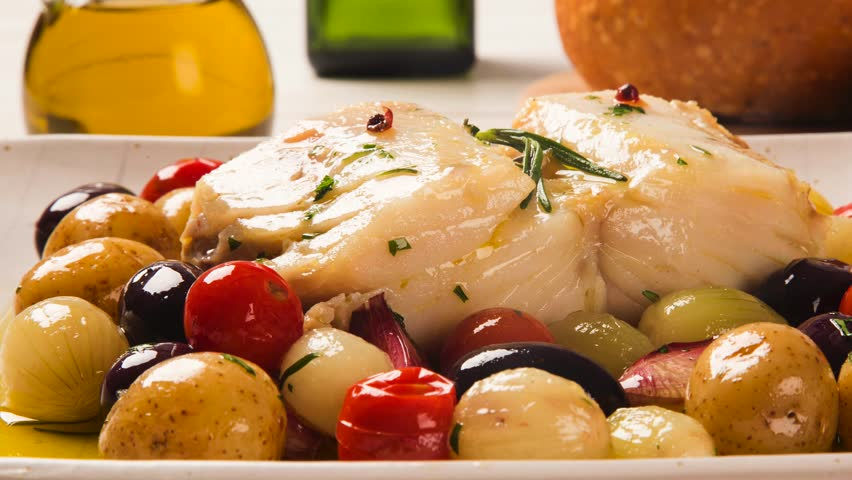 Slide shot typical Portuguese dish with codfish called Bacalhau do Porto with smoke. | Shutterstock HD Video #1026513323
