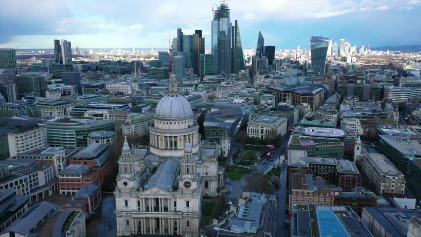 Aerial drone video of iconic Saint Paul landmark Cathedral in the heart of City financial district of London, United Kingdom