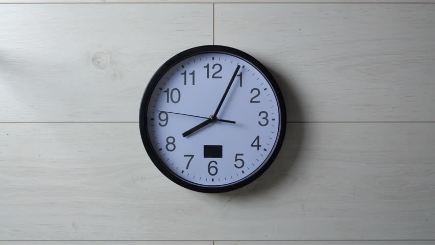 Clock ticking on the wallpapered wall   Shutterstock HD Video #1026541193