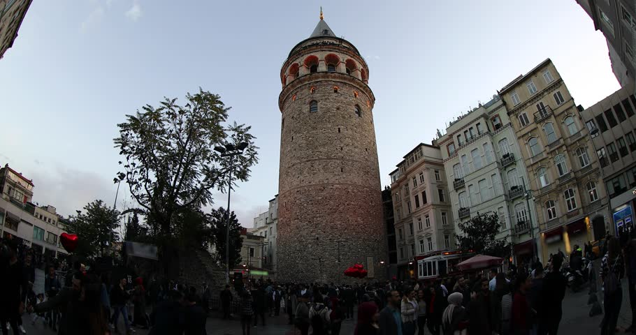 ISTANBUL, TURKEY- JANUARY 17, 2018 : place Galata tower is medieval stone tower in Karakoy squere Istanbul Turkey. Tourists visiting Galata Tower at evening. Time Lapse