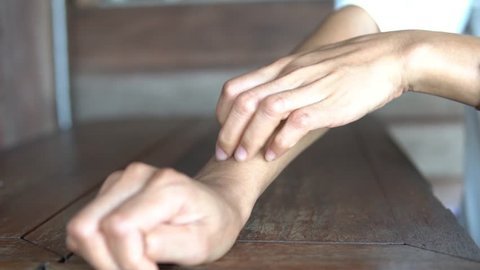Woman scratches the itch with hand on the table, Concept with Health care And Medicine.