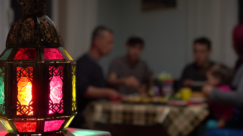Muslim Family Eating Dinner At Home. Ramadan is a time when families get together in the evening to break their fast | Shutterstock HD Video #1026628733