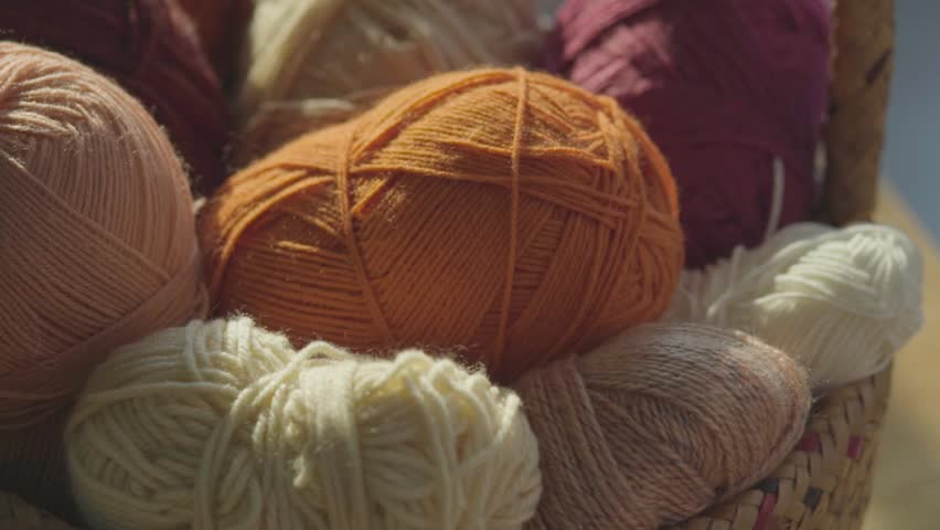 Baby yarns in basket. | Shutterstock HD Video #1026699623