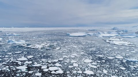 Antarctica Ice Polar Ocean Seascape Aerial View. Antarctic Open Water Surface Scenery Global Warming Concept Climate Change. Majestic North Pole Sea Wildlife Scene Drone Shot Footage 4K (UHD)