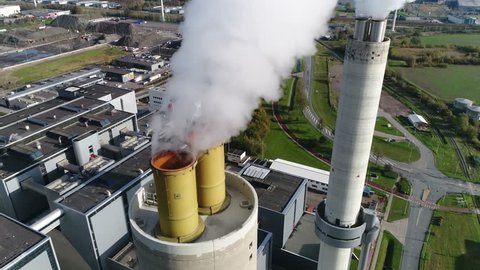 Aerial bird view of coal fired power plant thermal station flues this electricity production provides about 32 percent of consumed electricity in the United States showing thick white flue exhaust 4k
