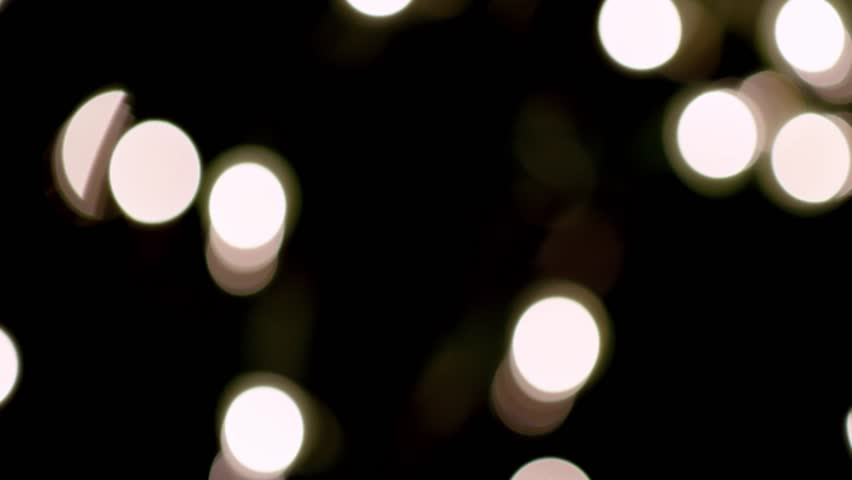 Bokeh lights on black great for backgrounds, motion graphics, or compositing. 4K beautifully shot.