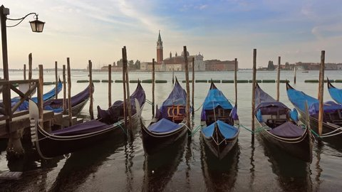 Traditional Gondolas on Canal Grande with San Giorgio Maggiore church in the background at morning, San Marco, Venice, Italy, 4k