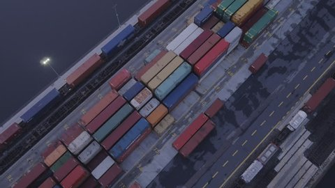 The drone rises above the colorful intermodal containers.