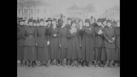 CIRCA 1919 - Civilian French and American women leave after a day's work at the AEF's Quartermaster Corps HQ.