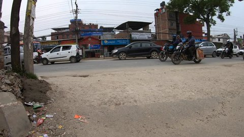 KATHMANDU, NEPAL - CIRCA MARCH 2019: Scooter ride hyperlapse in the streets of Kathmandu. Chabahil and Bouddha area.