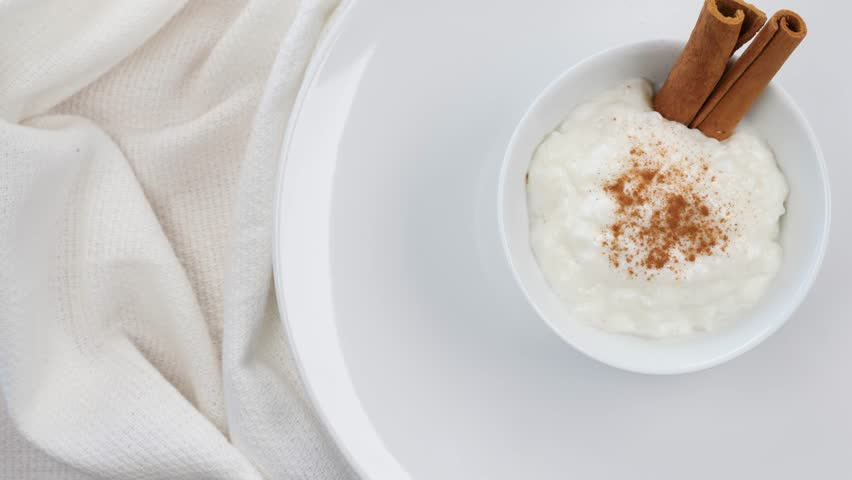 Rice pudding is a dish made from rice mixed with water or milk and other ingredients such as cinnamon and raisins. Variants are used for either desserts or dinners.