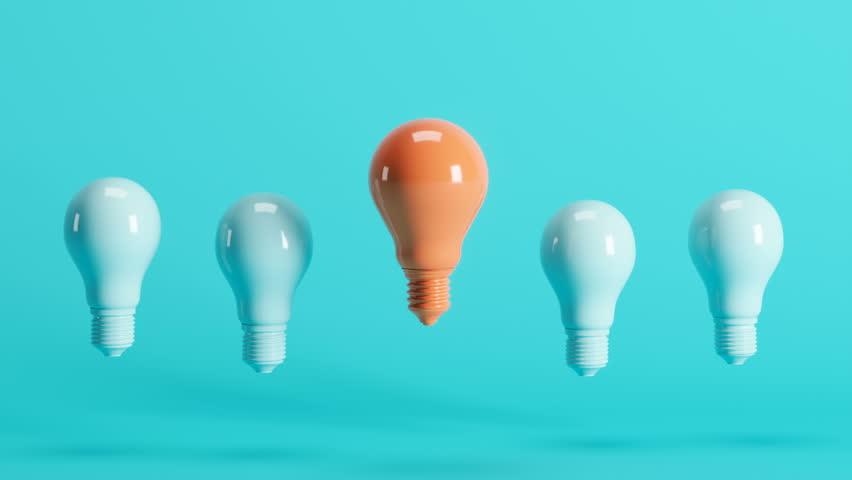 Outstanding orange light bulb among light blue light bulbs floating on blue background. 3D Animation.   Shutterstock HD Video #1027023893