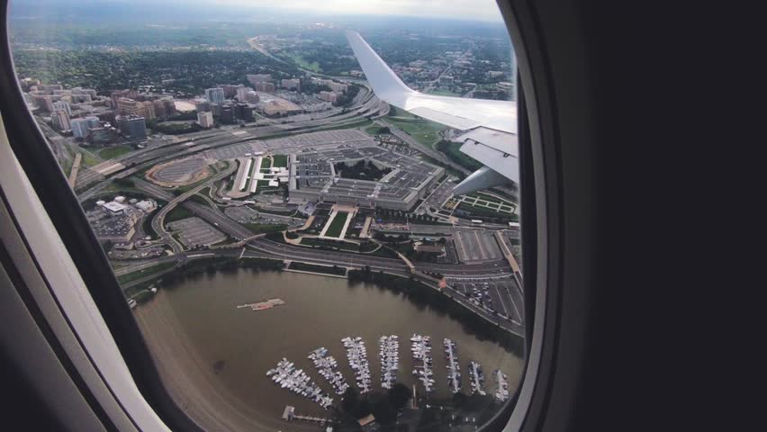 September 15, 2018. Washington DC, District of Columbia, USA. View of the Pentagon from the airplane window seat. Airplane flies over the Pentagon. Wing of an airplane flying above the clouds.