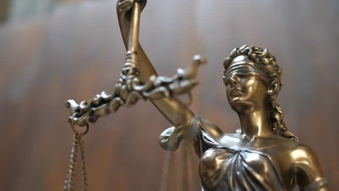 The Statue of Justice on Wooden Background. Concept of legal law, advice and justice