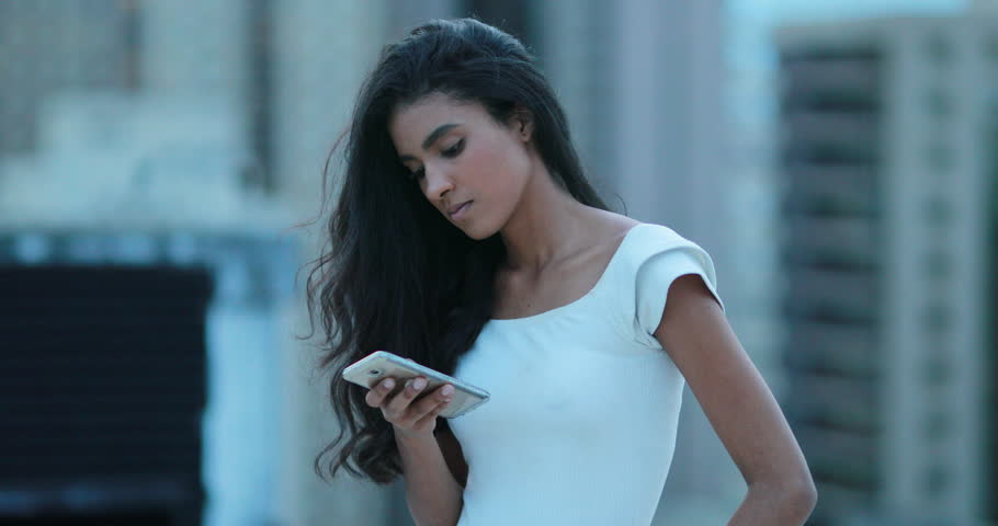 African girl holding smartphone device   Shutterstock HD Video #1027173293