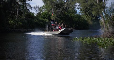 Everglades, Florida / United States - September 27, 2018: Tourists on Airboat Excursion, Everglades Swamp Slow Motion