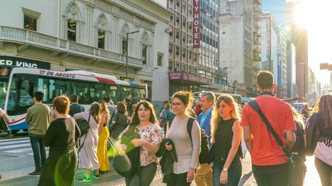 BUENOS AIRES, ARGENTINA - CIRCA NOVEMBER 2018: Time-lapse view on traffic and pedestrians pass by in the center of the city circa November 2018 in Buenos Aires, Argentina.