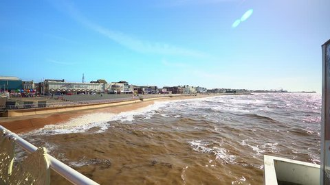 Blackpool, Lancashire - 25th March 2019 -Stunning view from the famous Blackpool pier at high tide, waves on the award winning Blackpool beach, A very popular seaside tourist location in England