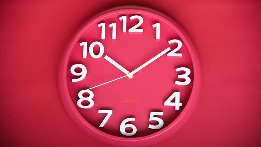 Closeup single clock hanging on red wall | Shutterstock HD Video #1027305383
