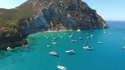 Aerial view of boats and yatchs in the turquoise water of Palmarola Island, Italy