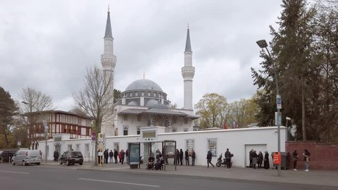 BERLIN, GERMANY - APRIL 12, 2019: Traffic In Front of Beautiful Sehitlik Mosque In Berlin, Germany In Spring