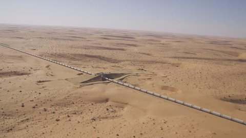 View from the air to a train in the desert of saudi arabia  it is the  longest train in the world  ( freight train for the aluminum industry-  ma'aden aluminium company ras al khair saudi arabia)