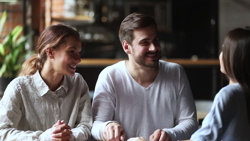 Happy young couple clients customers sign loan investment contract agreement making sale purchase real estate family mortgage deal handshake realtor broker insurer, taking loan, buying insurance | Shutterstock HD Video #1027488383