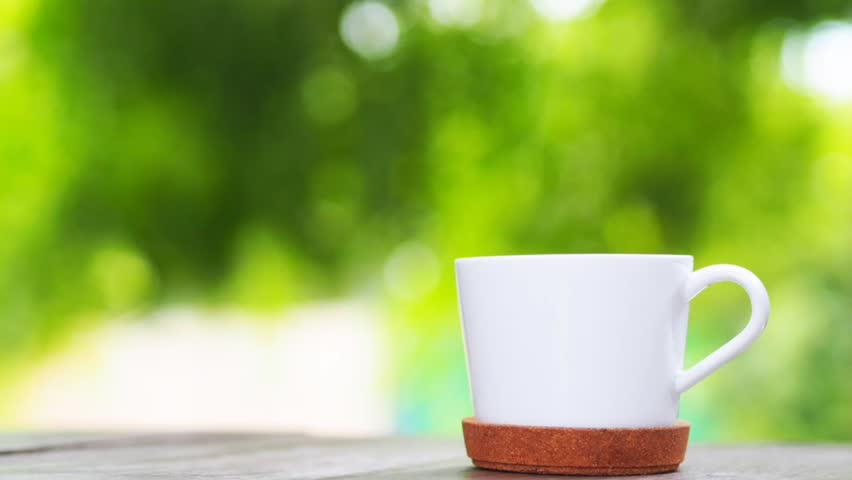Hot coffee cup on wooden table in the morning. | Shutterstock HD Video #1027534853