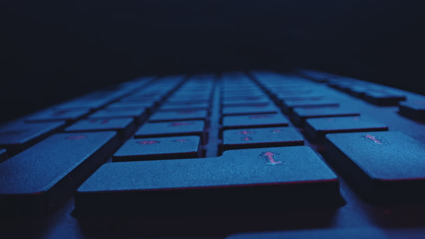 Closeup of a hacker typing on a dirty black computer keyboard  | Shutterstock HD Video #1027548893