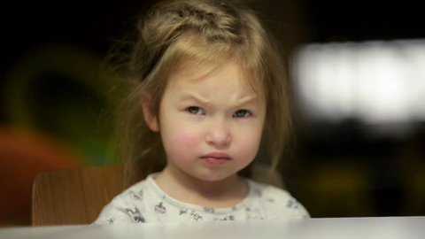 Portrait of Sad Girl Putting Her Head On Desk. Cutie Little Girl Is Going To Cry.