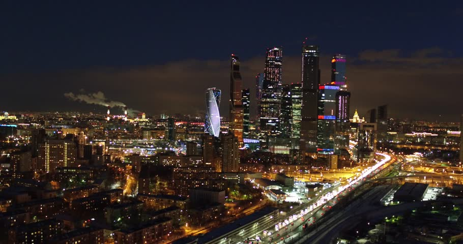 Aerial view night city on the background of the luminous towers of Moscow City, Russia | Shutterstock HD Video #1027610393