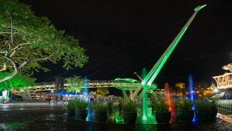 Colourful Fountain and Lightshow Near Kuching Waterfront With Iconic Darul Hana Bridge In The Background. Kuching, Sarawak, Malaysia