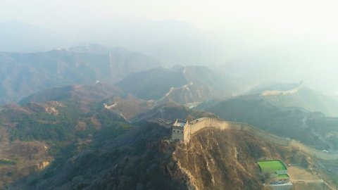 Great Wall of China and Green Mountains. Badaling Section. Aerial View. Drone Flies Forward, Reveal Shot