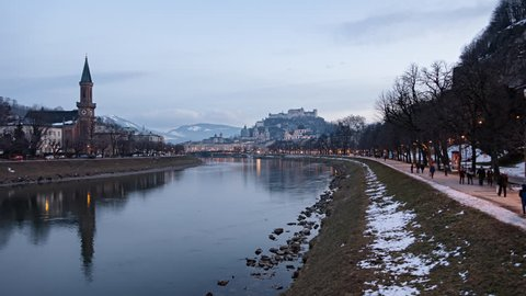 Day to night time lapse of Salzburg old town, Hohensalzburg Fortress, Salzburg Christuskirche and Salzach riverside, Austria.