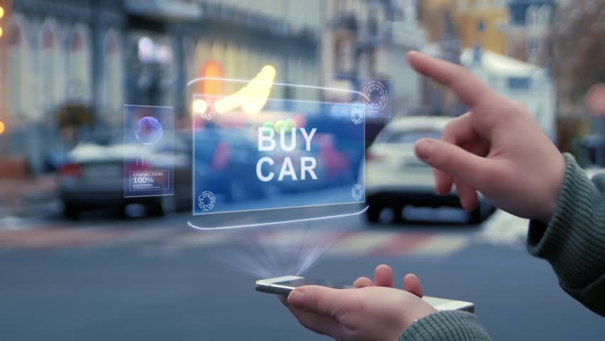 Female hands on the street interact with a HUD hologram with text Buy car. Woman uses the holographic technology of the future in the smartphone screen on the background of the evening city | Shutterstock HD Video #1027792973