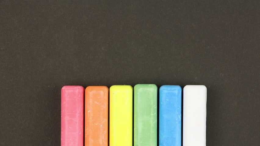 Six colored children crayons on black background lined in a row, rises sequentially, close-up, loop video, stopmotion animation, kindergarten education concept   Shutterstock HD Video #1027840043