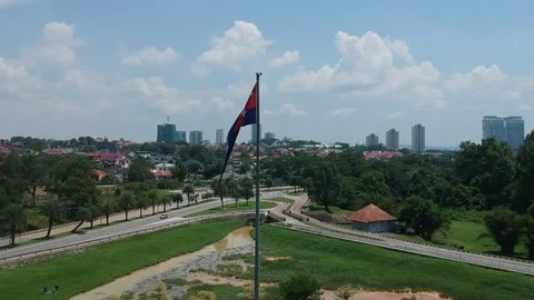 Johor Bahru, Malaysia - 10 20 2018: Johor Bahru is one Estate of Malaysia. Every Estate in Malaysia has its flag. This Drone Footage with a Johor Bahru Flag over looking the city center of Johor.
