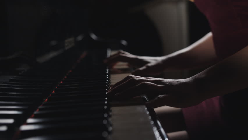 Close up fingers of woman pianist at the rusty piano keys, arms plays solo of music. Hands of female musician playing. | Shutterstock HD Video #1027882013