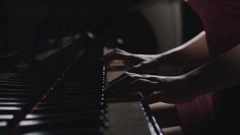 Close up fingers of woman pianist at the rusty piano keys, arms plays solo of music. Hands of female musician playing.