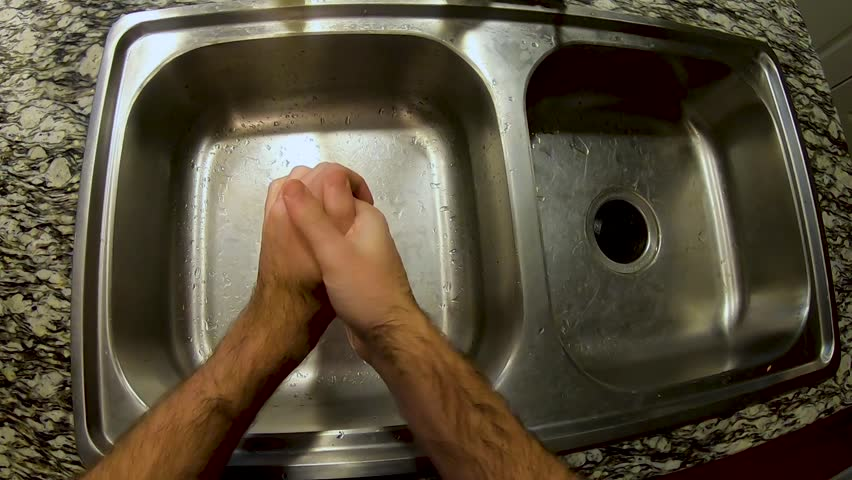First person view of man drying his hands with a towel in his apartment slow motion   Shutterstock HD Video #1027930793