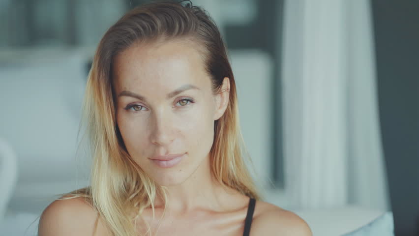 Beautiful woman looking at camera in slow motion | Shutterstock HD Video #1027936013