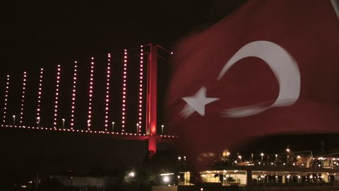 Close-up of the Turkish flag on the background of the bridge over the Bosphorus