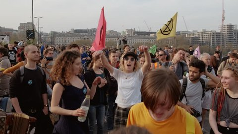 LONDON, circa 2019 - Extinction Rebellion demonstrators having a dance party in Waterloo Bridge in London, England, UK during a massive demonstration