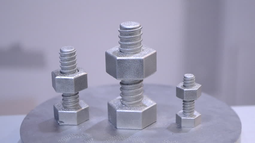 Object printed on metal 3d printer close-up. Object printed in laser sintering machine. Modern 3D printer printing from metal powder. Concept progressive additive DMLS, SLM, SLS 3d printing technology | Shutterstock HD Video #1028080013