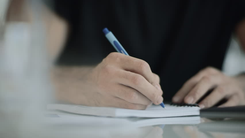 Man hand writing with pen at dairy. Closeup of business man hand write notes. Close up of male person hand holding pen. Professional person signature. Male student write page report | Shutterstock HD Video #1028144063